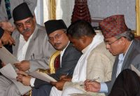 "On 18 August 2008 Pushpa Kamal Dahal ""Prachanda"", left, was sworn in as Prime Minister. He looks on as Finance Minister Baburam Bhattarai, second left, Foreign Minister Upendra Yadav, second right, and Defence Minister Ram Bahadur Thapa, right, check their papers before being sworn into the cabinet. AP PHOTO/BINOD JOSHI"