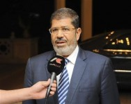 Egypt's President Mohamed Mursi speaks on Egyptian television before an emergency meeting at the presidential palace in Cairo August 5, 2012. REUTERS/Egyptian Presidency/Handout