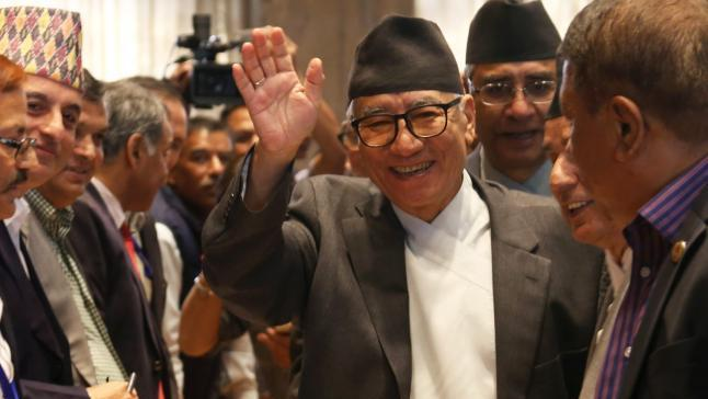 KATHMANDU, Oct. 27, 2015 (Xinhua) -- Nepali Congress leader Kul Bahadur Gurung (C) waves hands after filing his nomination for the election of President at Parliament in Kathmandu, Nepal, Oct. 27, 2015. The voting for the election is scheduled on Oct. 28. (Xinhua/Sunil Sharma/IANS)