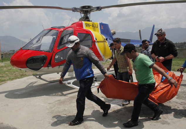 The body of Dutch climber Eric Arnold, who died last week near South Col during a Mount Everest expedition, is carried to Teaching hospital in Kathmandu, Nepal, Thursday, May 26, 2016. This year's busy climbing season follows two years of disasters that virtually emptied the mountain. (AP Photo/Niranjan Shrestha)